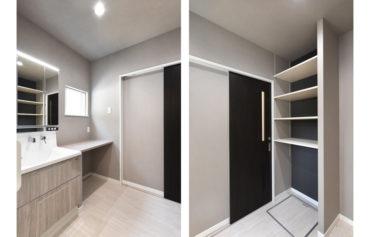 便利なカウンターがある洗面脱衣室。アクセントクロスを採用した収納棚もこだわり!